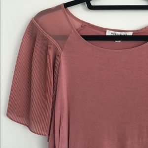 Top with see-through sleeves
